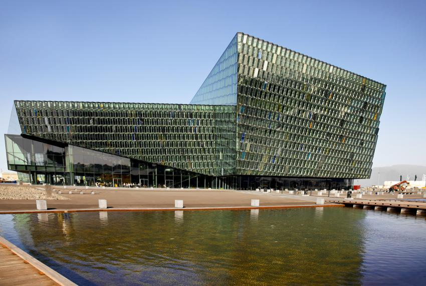 Harpa Concert Hall is known for its distinctive colored glass facade.